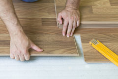 Installing wooden laminate flooring Royalty Free Stock Photo