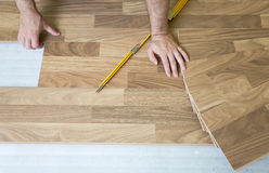 Installing wooden laminate flooring Royalty Free Stock Photography