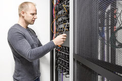 Installs communication rack in datacenter Royalty Free Stock Photos