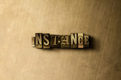 INSTANCE - close-up of grungy vintage typeset word on metal backdrop Stock Photography