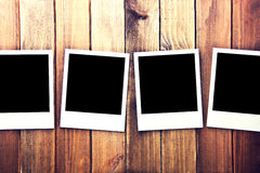 Instant blank polaroid photo frames. Instant blank polaroid photo frames on wooden background. Free copyspace. Vintage retro Stock Photo