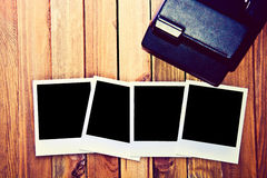 Instant blank polaroid photos frames. Instant blank polaroid photos frame on wooden background. Free copyspace. Vintage retro Royalty Free Stock Image