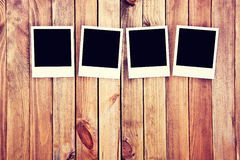 Instant blank polaroid photos. Instant blank polaroid photos frames on wooden background. Free copyspace. Vintage retro concept Stock Photo