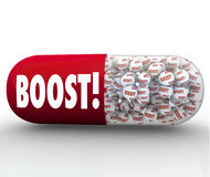 Instant Boost - Revitalize with Capsule Pill to Improve Health. A red capsule pill with the word Boost and small medicine balls inside it that is meant to Stock Image