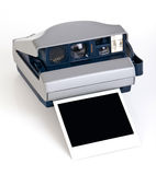 Instant camera. Polaroid-type instant camera with blank film ejected Stock Image
