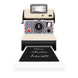 Instant camera with a blank photo Royalty Free Stock Images