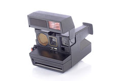 Instant camera in the foreground Royalty Free Stock Photo