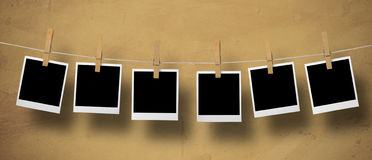 Instant Camera Frames. On a leash on a textured background Royalty Free Stock Photography