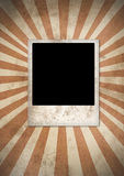 Instant camera photo frame. Classic instant photo frame over a grunge background Stock Image
