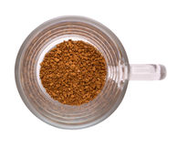 Instant coffee. Top view of instant coffee powder in a glass cup. Isolated Royalty Free Stock Images