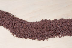 Instant coffee. On a wooden background Royalty Free Stock Photo