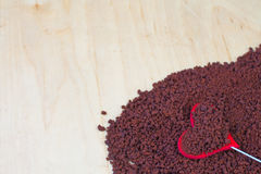 Instant coffee. On a wooden background  and heart Stock Photos