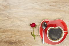 Instant coffee in a cup on a wooden table with a rose. Royalty Free Stock Photos