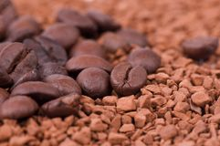Instant coffee and the grains of coffee Stock Images