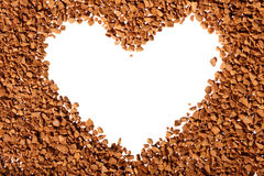 Instant coffee grains heart form. Instant coffee grains around heart contour Royalty Free Stock Photo