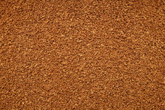 Instant coffee granules background Royalty Free Stock Image