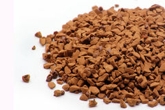 Instant coffee granules. Image of instant coffee granules on white Royalty Free Stock Image
