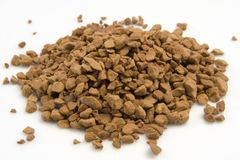 Instant Coffee Granules in a pile. Pile of brown instant coffee grains isolated on white background royalty free stock photography