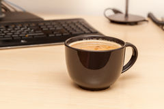 Instant coffee in modern office Royalty Free Stock Images