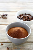 Instant coffee powder and Coffee beans in a bowl Stock Images