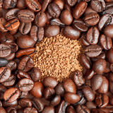 Instant coffee and roasted beans close up Stock Images