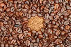 Instant coffee and roasted beans Stock Photos
