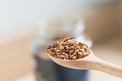 Instant coffee and a spoon Stock Images