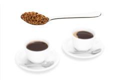 Instant coffee on spoon. Stock Photos