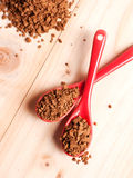 Instant coffee on spoon on wodden background Stock Image