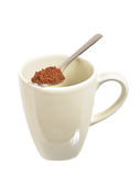 Instant coffee. Spoonfull of  over a cup Stock Images