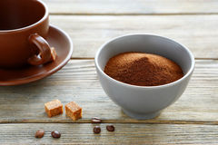 Instant coffee with sugar cubes in a bowl Royalty Free Stock Images