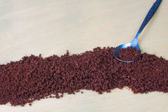 Instant coffee and teaspoon. Instant coffee background and teaspoon Royalty Free Stock Images