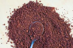 Instant coffee and teaspoon. Instant coffee on a wooden background  and teaspoon Royalty Free Stock Photo