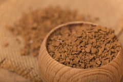 Instant coffee. In a wooden pot on a burlap sack Royalty Free Stock Photos