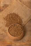 Instant coffee. In a wooden pot on a burlap sack Stock Photography