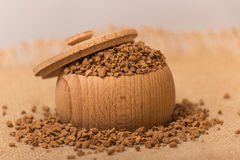 Instant coffee. In a wooden pot on a burlap sack Royalty Free Stock Photography