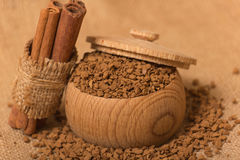Instant coffee. In a wooden pot on a burlap sack Stock Photo