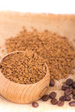 Instant coffee. In a wooden pot on a sack Royalty Free Stock Photo