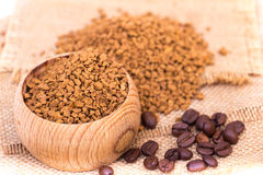 Instant coffee. In a wooden pot on a sack Royalty Free Stock Images