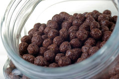 Instant crunch chocolate breakfast. Chocolate balls in a jar on the white background Stock Images