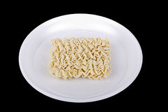 Instant dry noodles on the white plate Stock Photo