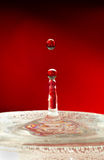 Instant. Falling water droplets Royalty Free Stock Images