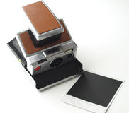 Instant film camera. Vintage instant film camera isolated on white Stock Photo