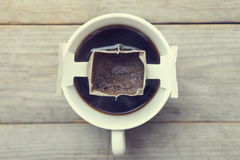 Instant freshly brewed cup of coffee. Drip bag fresh coffee royalty free stock photos
