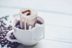 Instant freshly brewed cup of coffee. Drip bag fresh coffee stock images