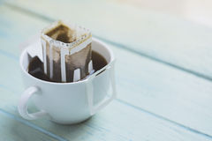 Instant freshly brewed cup of coffee,Drip bag fresh coffee. Close up royalty free stock photography