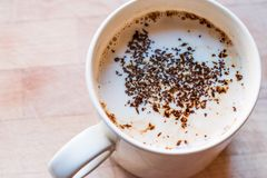 Instant Granulated Coffee Powder with Milk in Cup Stock Photos