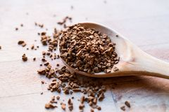 Instant Granulated Coffee Powder on Wooden Spoon. Stock Images