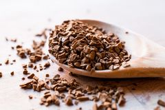 Instant Granulated Coffee Powder on Wooden Spoon. Stock Photography