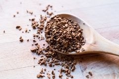 Instant Granulated Coffee Powder on Wooden Spoon. Royalty Free Stock Image